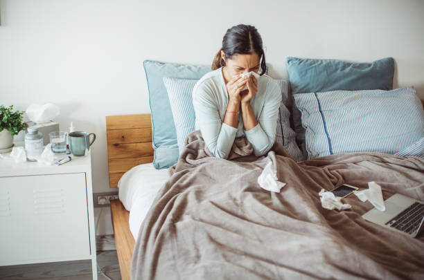 Flu attack Woman with flu in bed, she use home medicine to handle sickness flu stock pictures, royalty-free photos & images