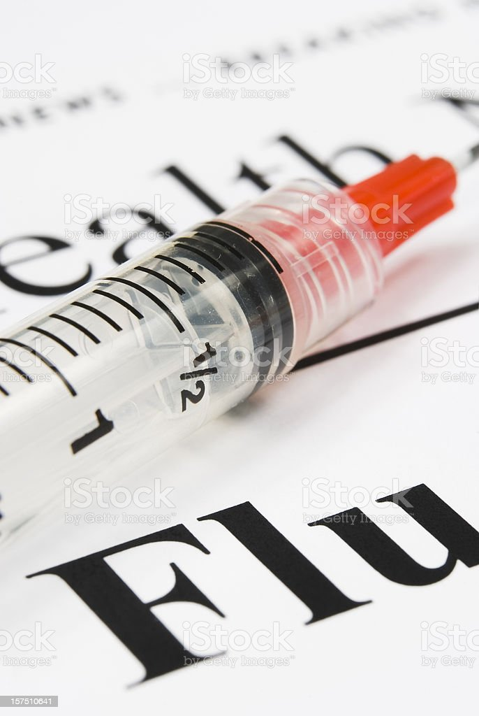 Flu health issue concept (red syringe close-up) - III royalty-free stock photo