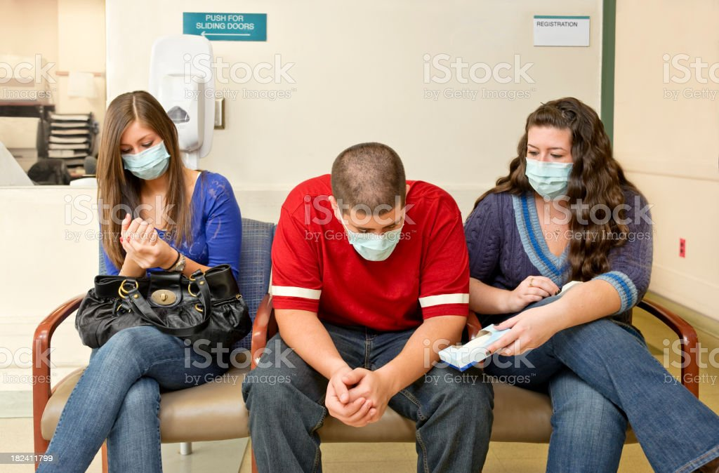 Flu in the waiting room of hospital stock photo