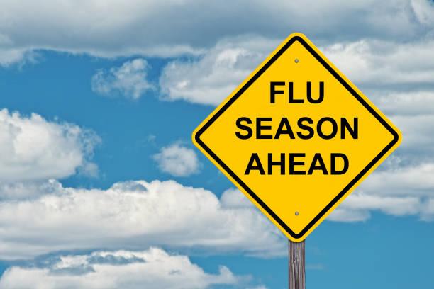 Flu Season Ahead Warning Sign stock photo