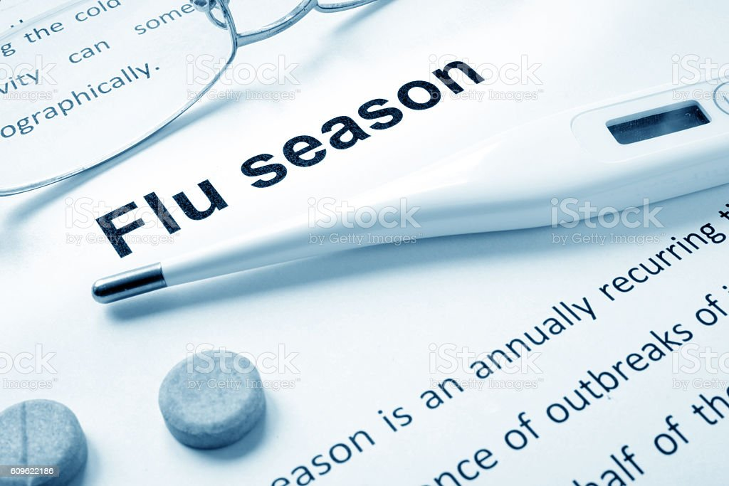 Flu season sign on a paper and glasses. stock photo