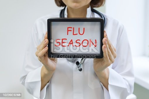 istock Flu season text in the hands of a female doctor 1023923268
