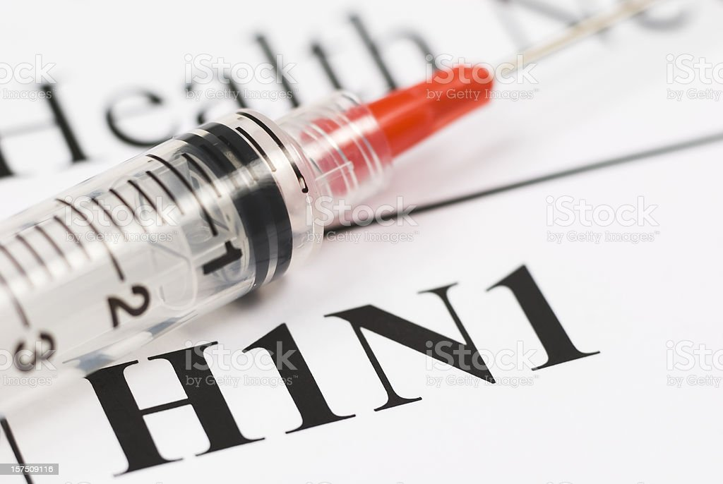 H1N1 Flu Shot, Vaccination close-up (red syringe) - I stock photo