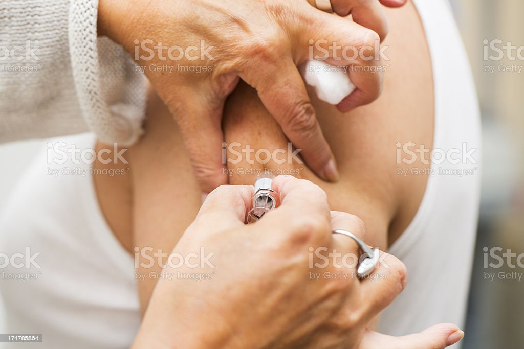 Flu vaccination...Nurse at work,vaccinating patient royalty-free stock photo