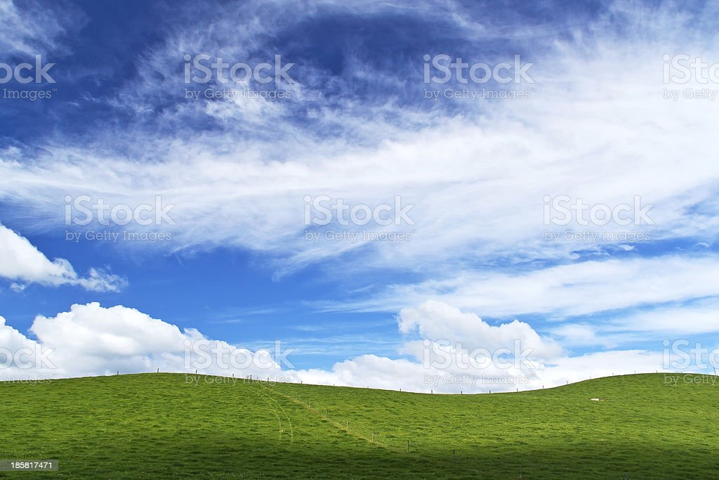 Fluffy clouds over the hill royalty-free stock photo