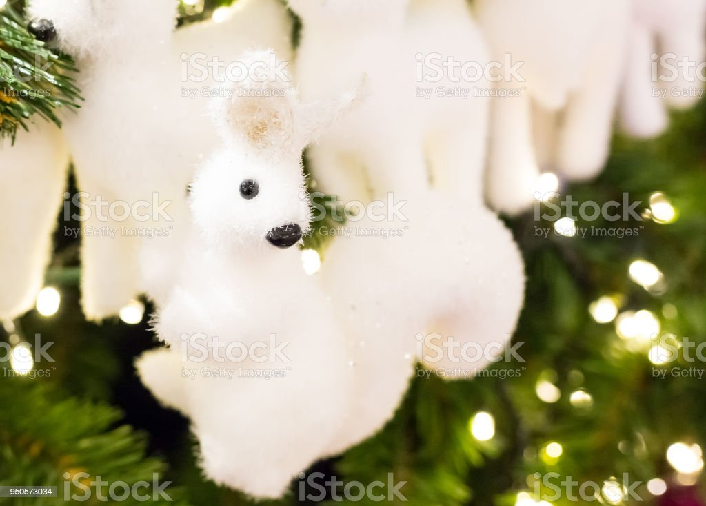 fluffy cute little toy white, festive decoration of a Christmas tree, design greeting card congratulation background new year stock photo