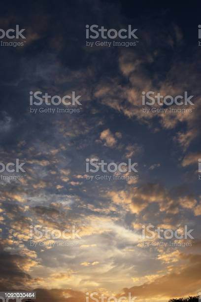 Photo of Fluffy scattered cloud at sunset
