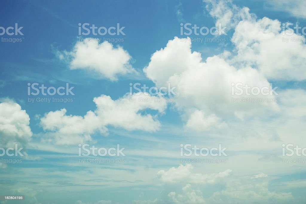 fluffy white clouds and blue sky stock photo