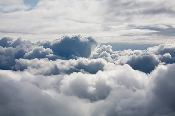 fluffy white clouds from above - stratosphere stock pictures, royalty-free photos & images