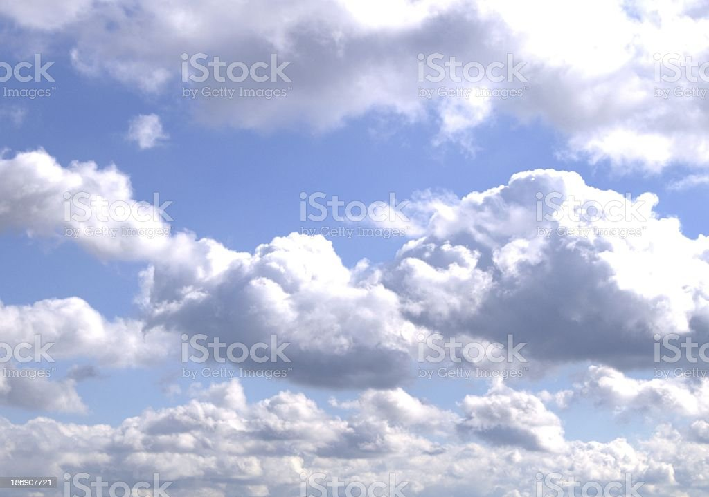 Fluffy, white clouds on blue sky background royalty-free stock photo