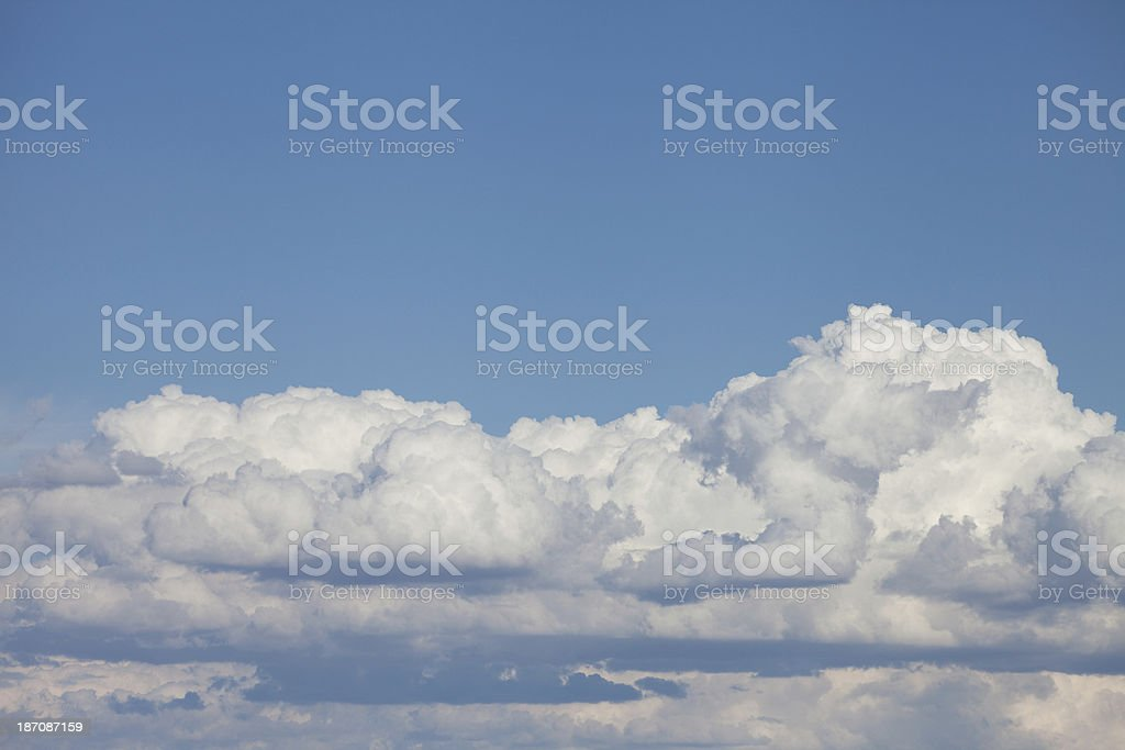 Fluffy White Cumulus Clouds and Blue Sky royalty-free stock photo