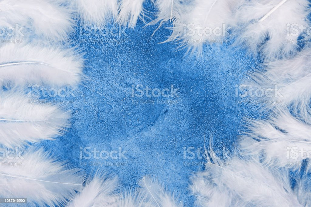 Fluffy White Feathers Forming A Frame On A Light Blue Marble Or Concrete Background Stock Photo Download Image Now Istock