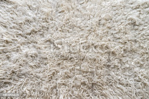 Fluffy wool rug with long hair in beige texture stock for Dark beige carpet texture