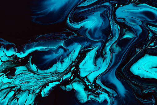 Fluid art texture. Abstract backdrop with swirling paint effect. Liquid acrylic picture with flows and splashes. Mixed paints for website background. Blue, black and aquamarine overflowing colors