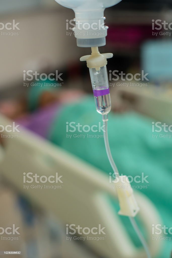 IV fluid intravenous drop saline drip in hospital ,Medical Concept. stock photo