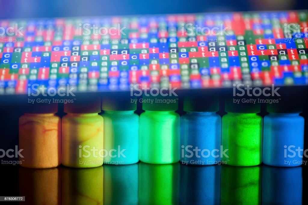 fluorescence materials excited with UV light in lab with DNA sequence code stock photo
