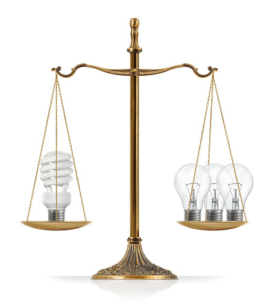 Fluorescent And Filament Light Bulbs Comparison Stock Photo - Download Image Now