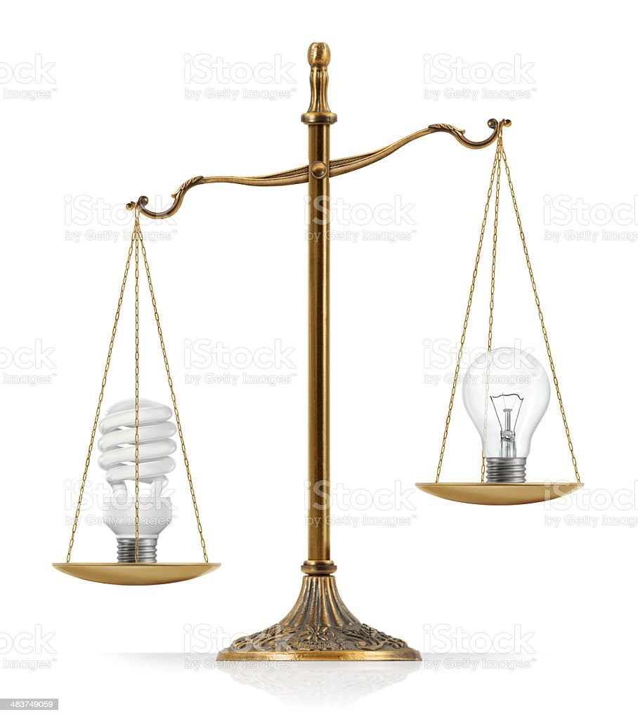 """Fluorescent and Filament Light Bulbs Comparison There is compact fluorescent light bulb at the one side of """"Scales of Justice"""" while there is classic (incandescent / filament) light bulb on the other side. In this version, compact fluorescent light bulb seems heavier than classic light bulb. Isolated on white background. Balance Stock Photo"""