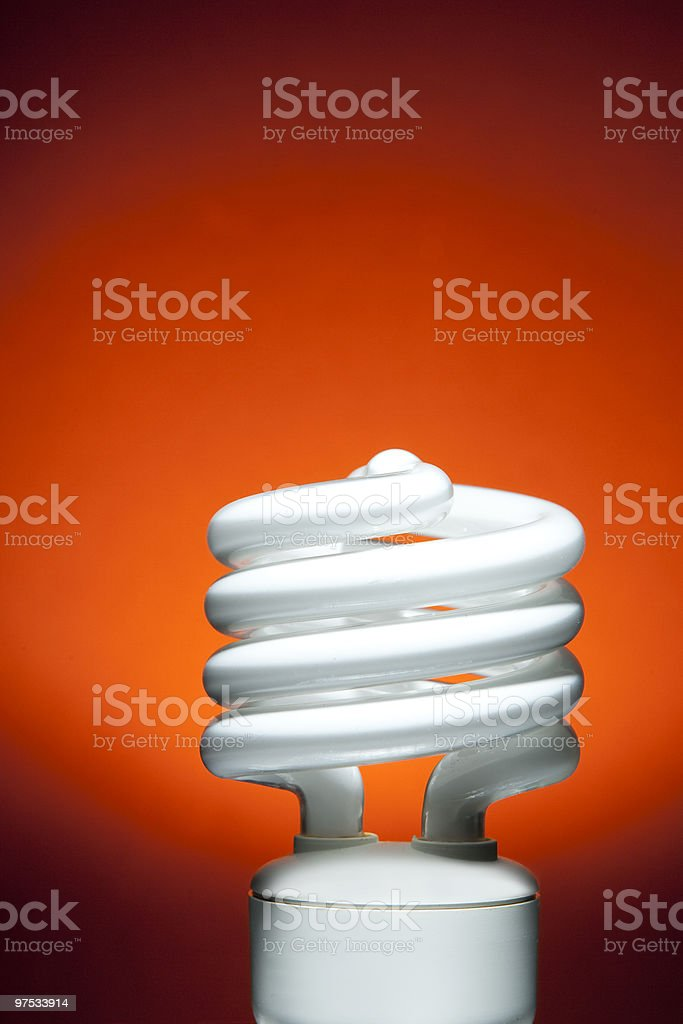 Fluorescent Bulb on Red Orange Spot Background royalty-free stock photo