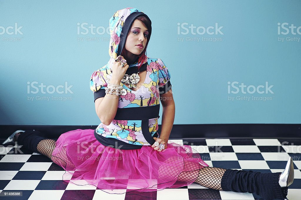 Fluorescent Hoodie Girl in Pink Skirt on Checkered Tile royalty-free stock photo