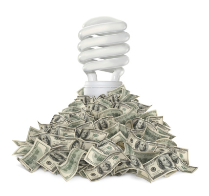 Fluorescent Lightbulb And Dollars Stock Photo - Download Image Now
