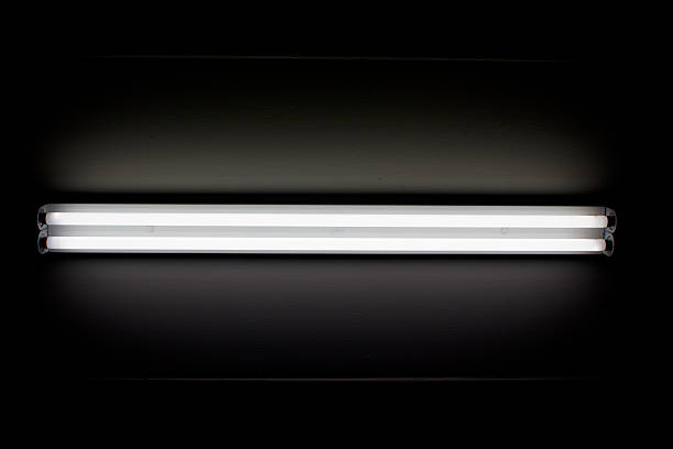 fluorescent mounted on wall - fluorescent light stock pictures, royalty-free photos & images