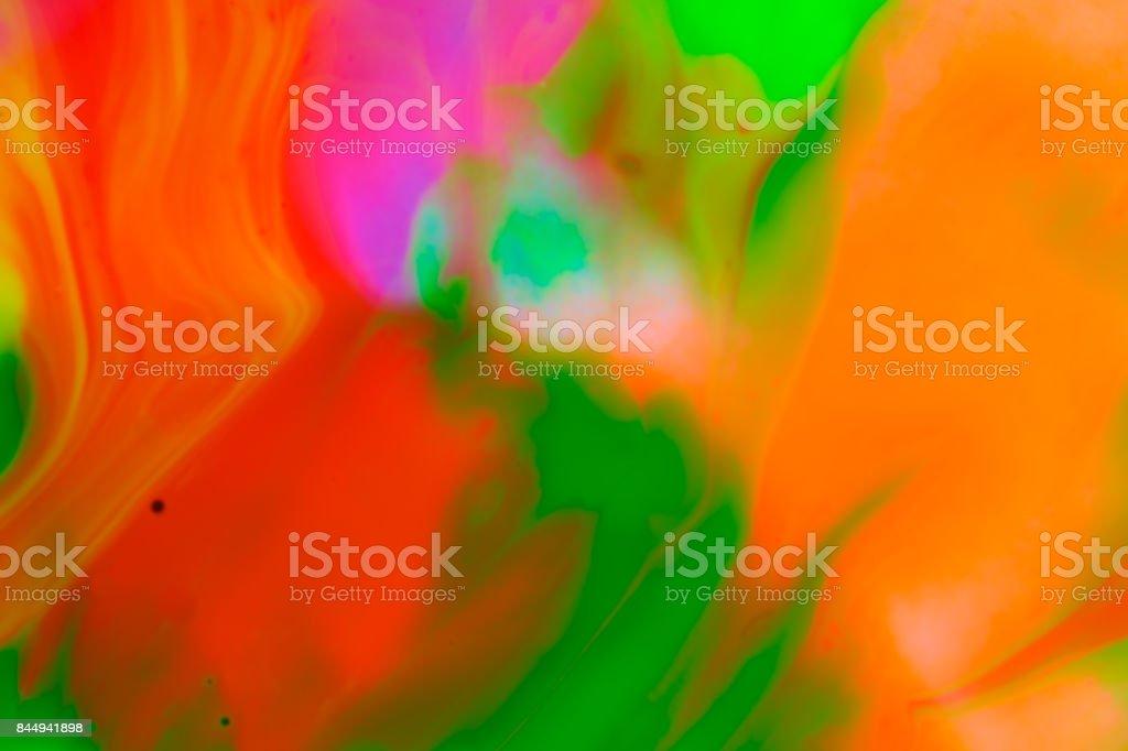 Fluorescent paint patterns under black ultraviolet light stock photo