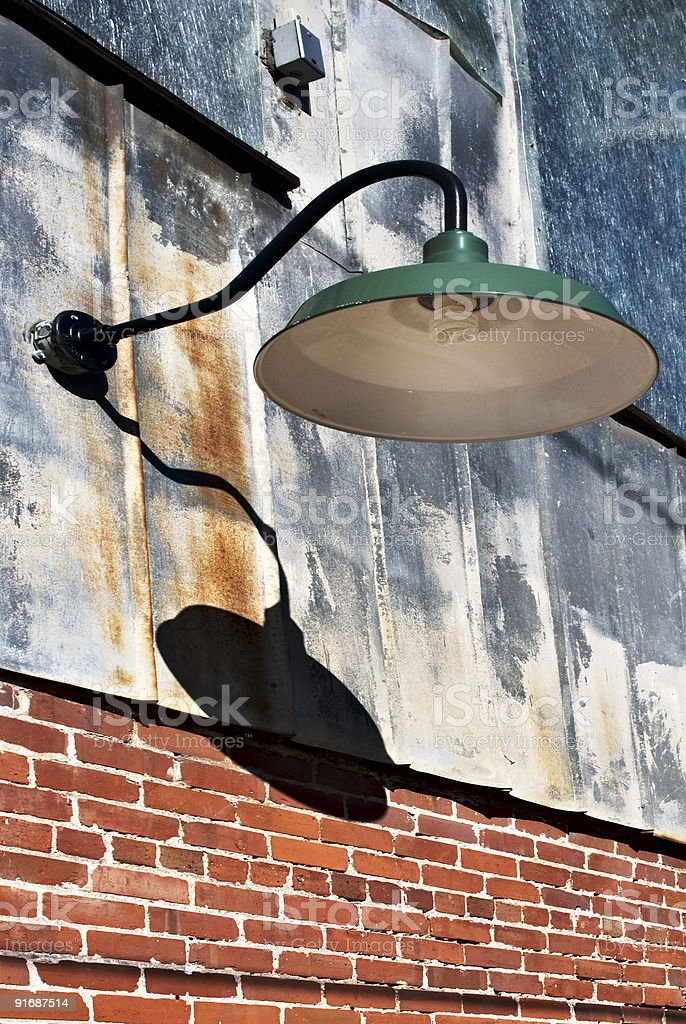 fluorescent street light on the side of an old building royalty-free stock photo