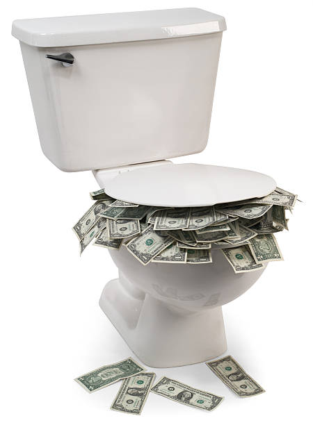 Flush with cash  flushing toilet stock pictures, royalty-free photos & images