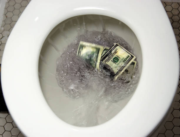 Flushing Money Like flushing money down the drain. money to burn stock pictures, royalty-free photos & images