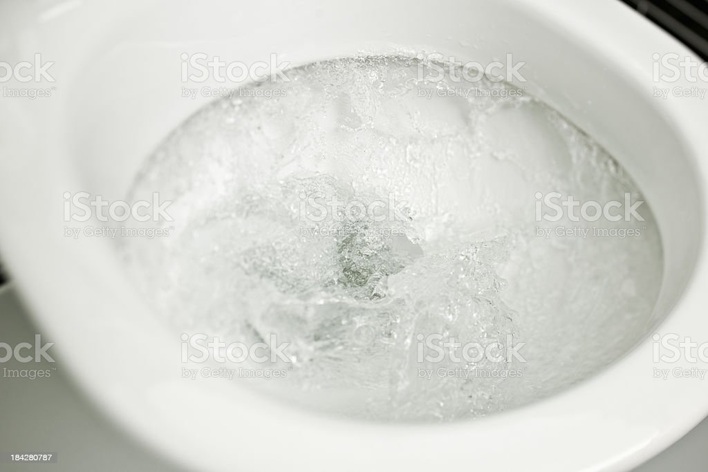 Flushing toilet stock photo