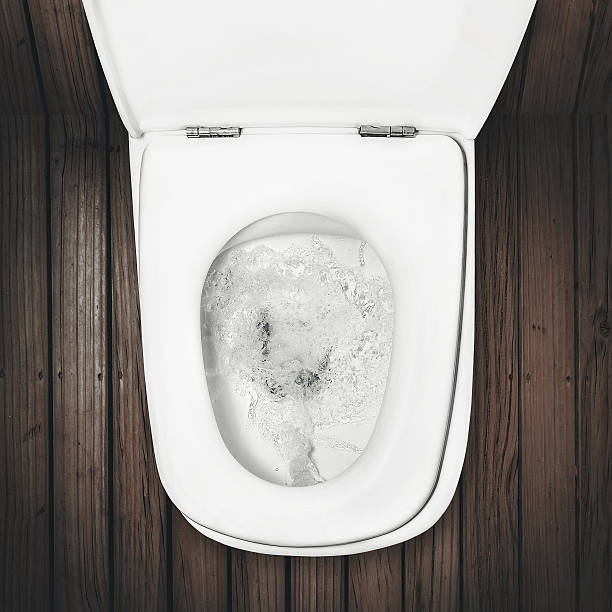 flushing toilet a flush toilet on wood floor flushing water stock pictures, royalty-free photos & images