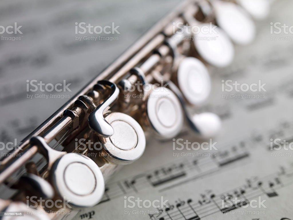 flute and music sheet, XIX century Puccini Aria stock photo