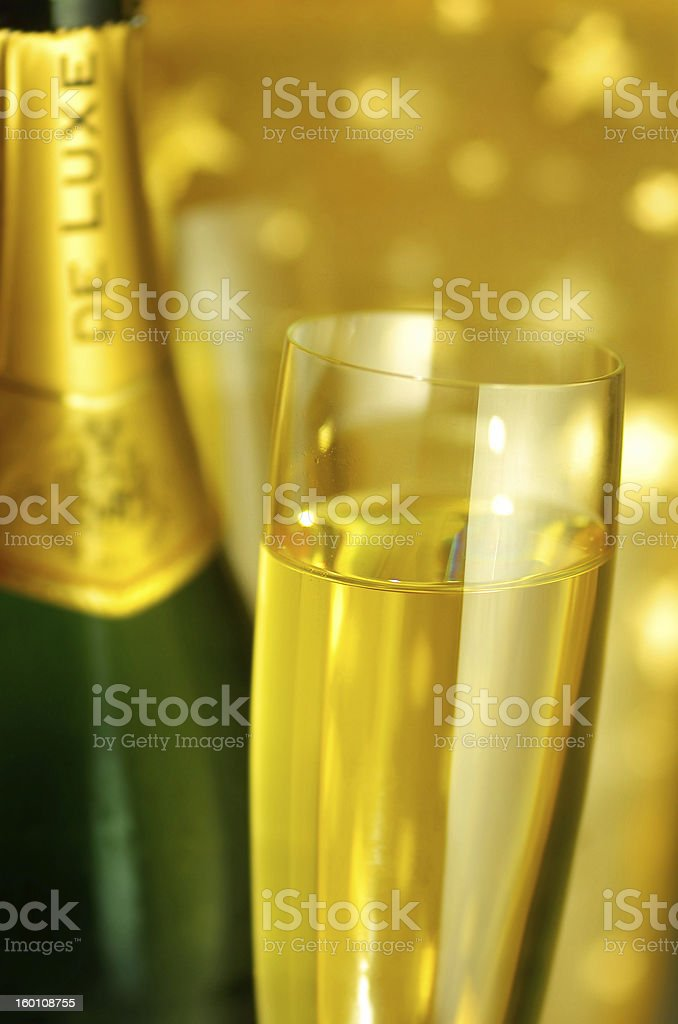 Flute glass and a bottle of Champagne royalty-free stock photo