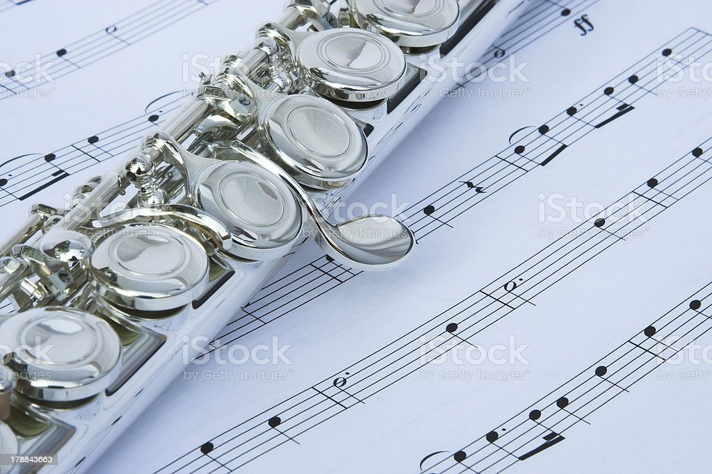 Flute keys on music notes royalty-free stock photo