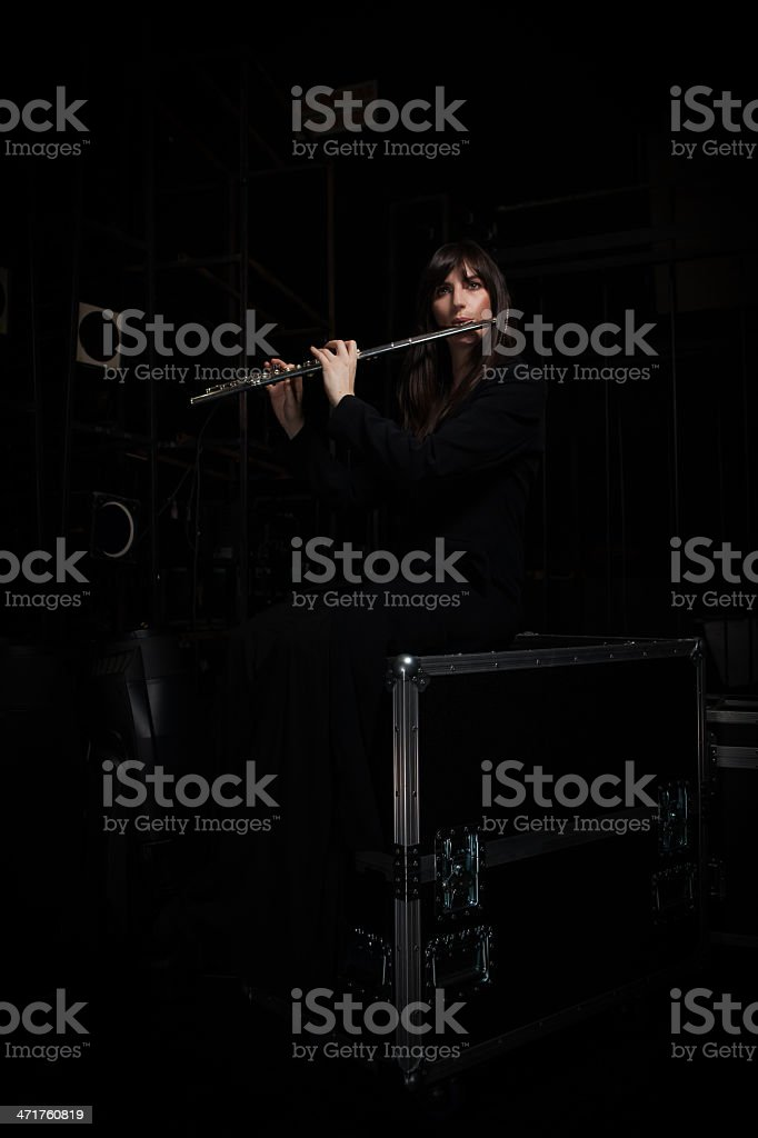 Flute player warming up backstage stock photo