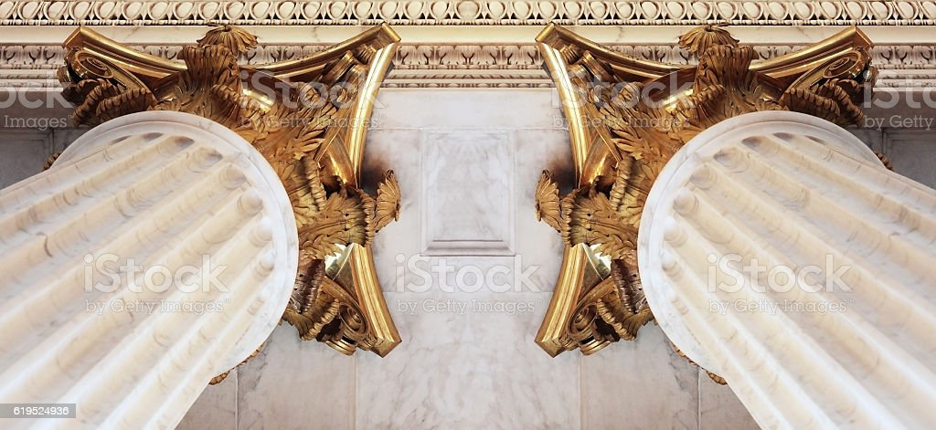 Fluted baroque columns with gilded Corinthian capitals supporting fretwork ceiling stock photo