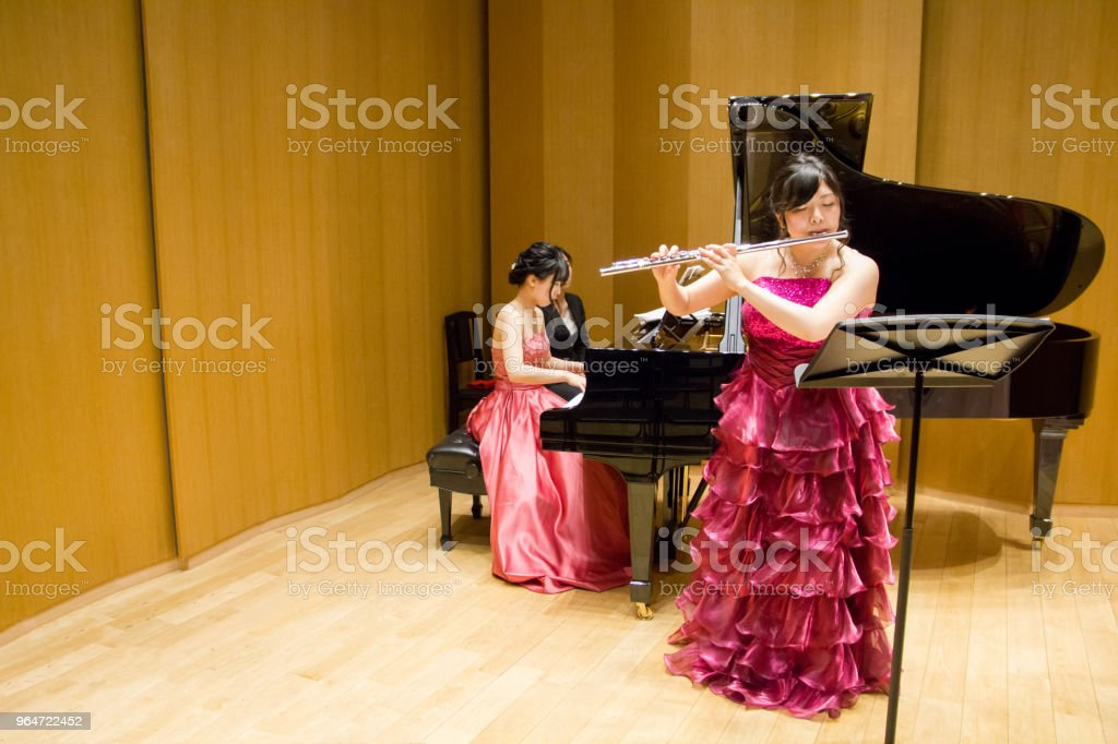 Flutist and Pianist on stage, Rehearsal royalty-free stock photo