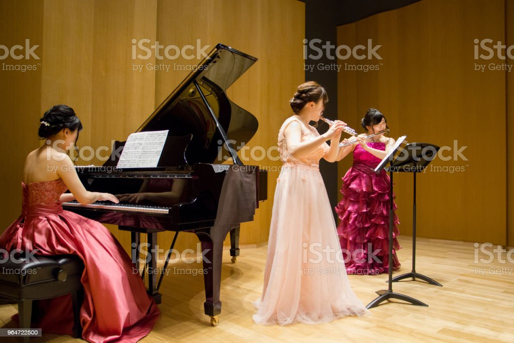 Flutist and Pianist Playing Music in a Concert royalty-free stock photo