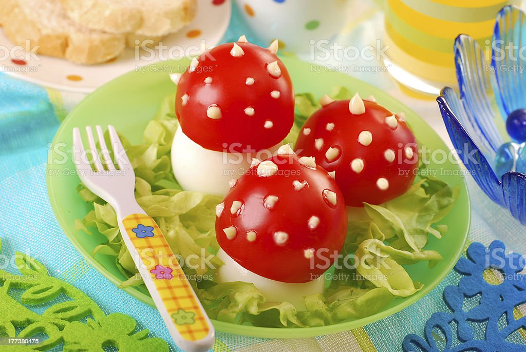 fly agaric made from egg and tomato stock photo