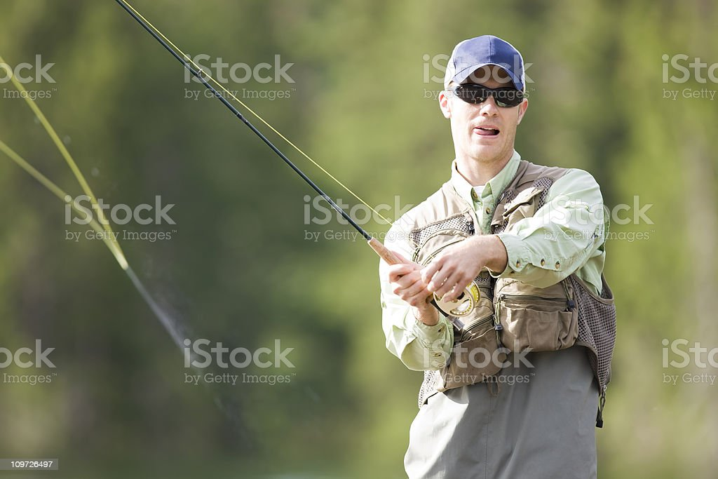 Fly Fisher Casting royalty-free stock photo