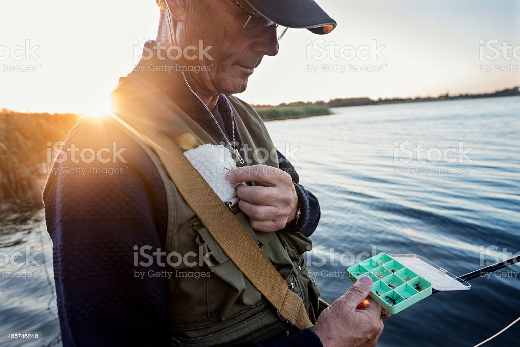 Fly Fisherman Choosing a Fly To Fish With stock photo