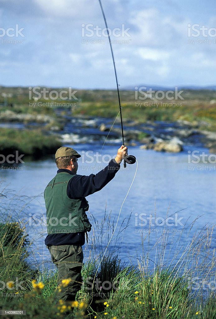 Fly fisherman in Ireland River royalty-free stock photo