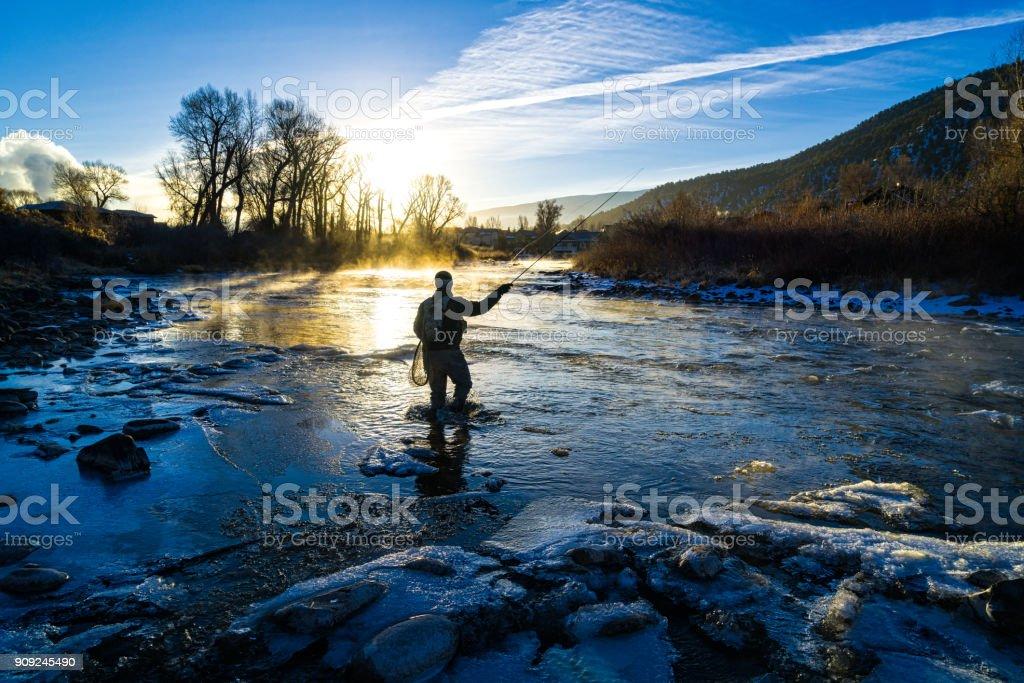 Fly Fisherman Winter Fishing stock photo