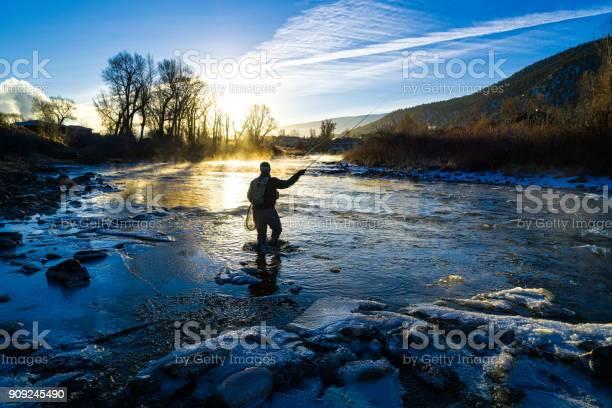 Photo of Fly Fisherman Winter Fishing