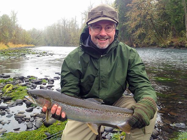 Fly Fisherman with Steelhead stock photo