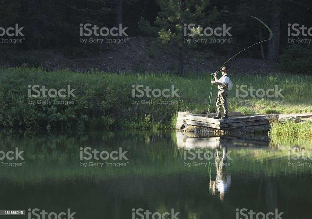 Fly fisherman working Fawn Lakes, Red River, New Mexico royalty-free stock photo