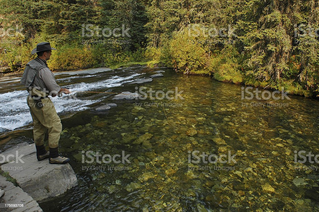 Fly fishermen and waterfall royalty-free stock photo