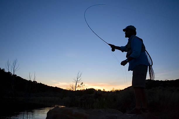 Fly Fishing at Sunset-horizontal stock photo