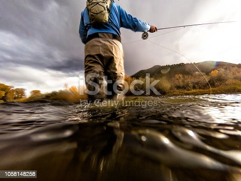 Fly Fishing Casting - Scenic river location lifestyle and leisure outdoor life.